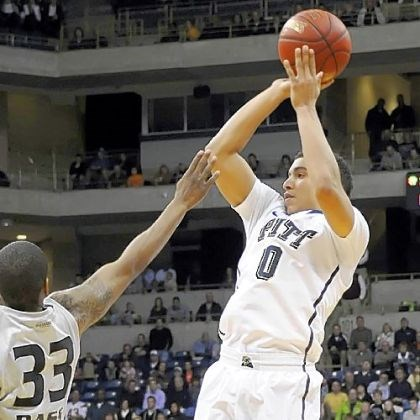 Robinson.jpg Pitt's James Robinson puts up a shot against Oakland''s Ryan Bass in the second half at the Petersen Events Center Saturday night.