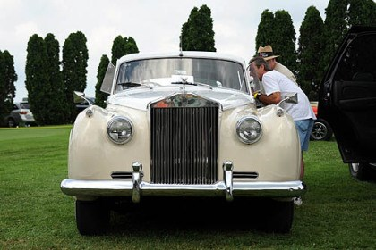 Rolls Royce Mike Lignini, of Greenfield and Ray Legnine of Penn Hills look over the 1961 Rolls Royce on display at the Pittsburgh Vintage Grand Prix in Schenley Park.