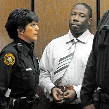 Ronald Robinson escorted Ronald Robinson is escorted from Judge Kevin Sasinoski's courtroom for a lunch recess on the first day of his murder trial Thursday.