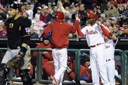 Russell Martin The Pirates' Russell Martin, left, walks back to the plate while the Phillies' Jonathan Pettibone, center, celebrates with Ryan Howard after scoring on a wild pitch from A.J. Burnett in the third inning.