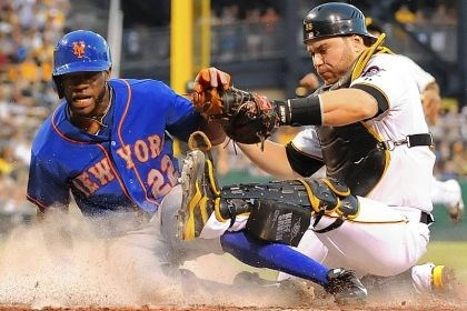 Russell Martin and Eric Young Pirates catcher Russell Martin tags out Mets Eric Young at the plate during the fifth ininng at PNC Park.