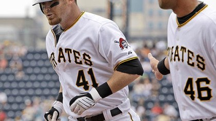 Ryan Doumit and Garrett Jones Pirates catcher Ryan Doumit (41) is greeted by first baseman Garrett Jones (46) after hitting a first-inning solo home run off Brewers pitcher Jeff Suppan.