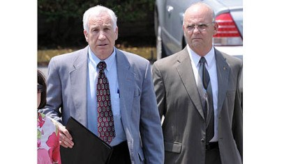 sandusky leaves day 8 Jerry Sandusky leaves the Centre County Courthouse after the jury began deliberating his case. At right is Centre County Sheriff Denny Nau.
