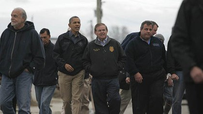 sandy storm President Barack Obama, second from left, Sen. Bob Menendez, D-N.J., center and New Jersey Gov. Chris Christie, second from right, examine damage in Brigantine, N.J. Sandy, the storm that made landfall Monday, caused multiple fatalities, halted mass transit and cut power to more than 6 million homes and businesses.