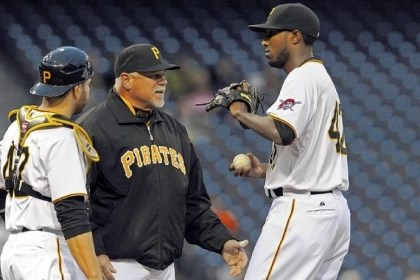 searage Pirates pitching coach Ray Searage talks to starting pitcher James McDonald in the second inning Monday at PNC Park.