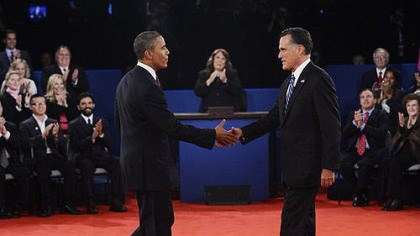 second presidential debate Moderator Candy Crowley, center, applauds as President Barack Obama shakes hands with Republican presidential nominee Mitt Romney during the second presidential debate at Hofstra University.
