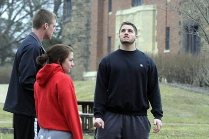 "Seton Hill students Seton Hill University students Julia Chessa, 19, foreground, Dylan Everett, 18, left, and Tyler Zimmer, 20, discuss on campus the bus crash. Tyler, a junior football player, says ""The accident is heartbreaking."""