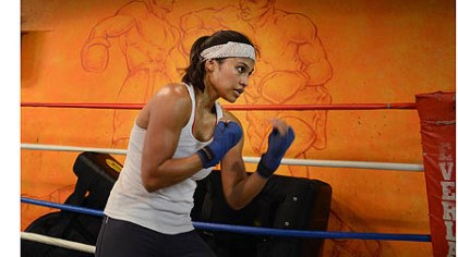 shadowboxing Jennifer Dugwen Chieng shadowboxes Tuesday at the Third Avenue Boxing Gym in Downtown Pittsburgh.