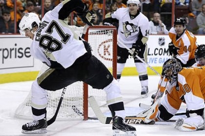 Sidney Crosby Philadelphia Flyers goalie Ilya Bryzgalov watches as the Penguins' Sidney Crosby (87) tries to control the puck during the first period.