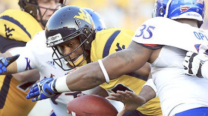 Smith.jpg West Virginia quarterback Geno Smith is sacked by Kansas' Toben Opurum (35) and John Williams (71) during the second quarter.