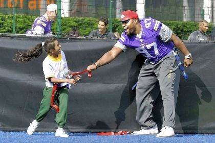 Steele1 The Minnesota Vikings, already in London for their game against the Steelers, took part in a football clinic for children Tuesday near Wembley Stadium site of the game Sunday. Everson Griffen teaches a young girl the basics of flag football.