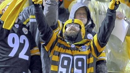 Steelers IMPLORING THE GODS? A Steelers fan who braved the elements Monday night at Heinz Field does his best to will the team to victory. The Steelers went to 6-3 with a 16-13 overtime victory against Kansas City.