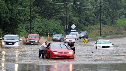 stranded vehicles part two flooding Jason Donahue, left, of Clairton and Dustin Tichenor of Bethel Park push their vehicle to safety after it was stranded in rising water on Route 51 near Bausman Street.