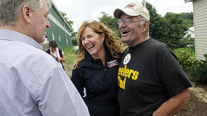 Survivor and nurse Quecreek mine survivor John Unger, right, shares a laugh Saturday with Jill Stull, a flight nurse for Conemaugh Memorial Medical Center, and former Gov. Mark Schweiker at the 10th anniversary celebration of the rescue at the site of Quecreek Mine in Somerset.