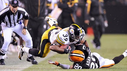 Tackle Willie Parker is tackled by Mike Adams.