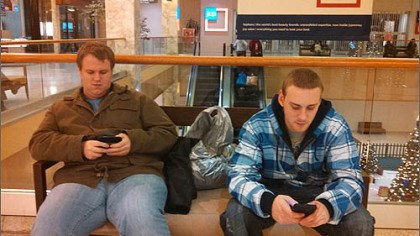 taking a 3 am break Bobby Walsh, 20, of Monroeville, left, and Garrett Lott, 24, of Penn Hills, take a break from shopping at the Monroeville Mall just after 3 a.m. Both men started their night of shopping more than 6 hours earlier at Wal-Mart.