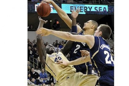 Talib Zanna Notre Dame forward Zach Auguste blocks a shot by Pitt forward Talib Zanna in the first half at the Petersen Events Center Monday.