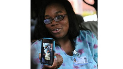Taliesha Woodson Taliesha Woodson, sister of Rhonda King, mother of Bryce, the kidnapped baby from Magee Hospital, talks to reporters and holds a photo of the boy after he was safe back at the hospital.