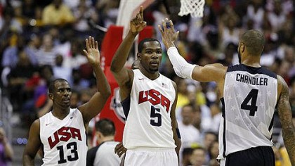 Team USA celebrates Team USA's Chris Paul (13), Kevin Durant (5), and Tyson Chandler (4) celebrate during the second half of a men's Olympic exhibition basketball game against Brazil, Monday, July 16, 2012, in Washington. USA won 80-69.