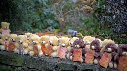 Teddy bears Teddy bears, each representing a victim of the Sandy Hook Elementary School shooting, sit on a wall at a sidewalk memorial Newtown, Conn.