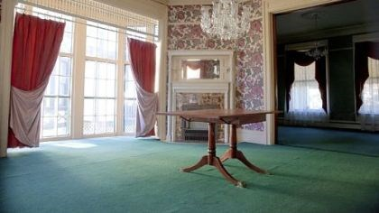 The dining room The dining room features large windows (there are 43 in the home), period wallpaper and the original fireplace mantel.