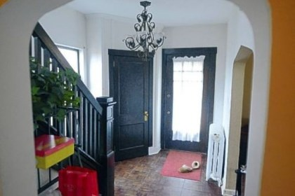 The entryway A full-view front door leads to a 13- by 8-foot entry with dark parquet floors.