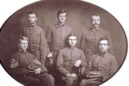 This photo, made in May 1861 This photo, made in May 1861, shows the Pittsburgh Rifles wearing gray uniforms supplied by Pittsburgh citizens. The men later joined Company A of the 9th Pennsylvania Reserves. In the front row, left to right, are Sergeant Hartley Howard, Private George T. Robinson and Private George W. Dilworth. From left to right in the back row are Private John S. Copley, Private George J. Hazlett and Abner Updegraff Howard, brother of Sgt. Hartley Howard.
