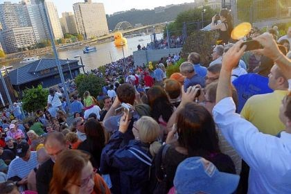 Thousands of people near PNC Park Thousands of people near PNC Park vie for a peek and snapshot of the peep on its way up the Allegheny River.