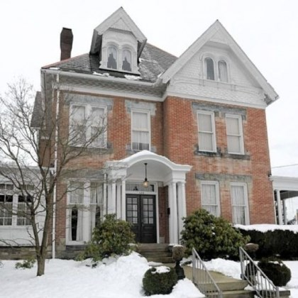 three-story house The three-story Victorian is on the market for $316,000.