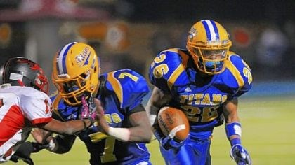 Titans West Mifflin's Jimmy Wheeler, following a block from teammate Diallo Mitchell, is second in the WPIAL in rushing with 1,543 yards.