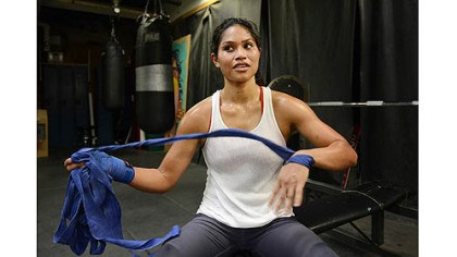 Unwrapping her hands Jennifer Dugwen Chieng unwraps her hands Tuesday after her workout at the Third Avenue Boxing Gym in Downtown Pittsburgh.