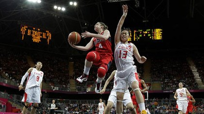 USA vs. China USA's Lindsay Whalen (4) drives past China defender Chen Xiaoli (13) during a preliminary women's basketball game.