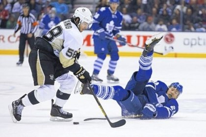 VanRiemsdyk Toronto's James van Riemsdyk, right, tries to play the puck from his back against the Penguins' James Neal in the second period Saturday night in Toronto.