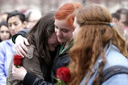 vigil Emma MacDonald, 21, left, is comforted by Rachael Semplice, 22, center, as Juliana Hudson, 23, looks on Tuesday during a vigil at Boston Common for the victims of the Boston Marathon explosions.