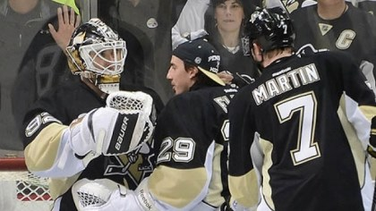 vokoun Penguins goalie Tomas Vokoun celebrates with Marc-Andre Fleury and Paul Martin after shutting out the Islanders, 4-0, at Consol Energy Center Thursday night.