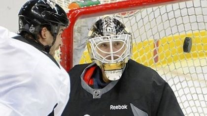 Vokoun Tomas Vokoun, expected to back up Marc-Andre Fleury in goal this season, makes a save at an informal workout Thursday at Consol Energy Center. Because of the shortened season after the 112-day lockout, goalies likely will be under pressure more than usual.
