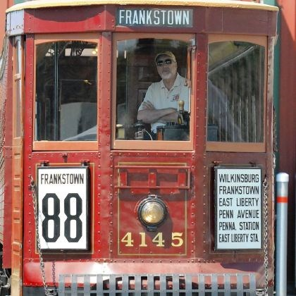 Volunteer Volunteer Alex Bruchac takes the driver's seat of a 1911 trolley.