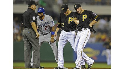 walker Pirates' Neil Walker argues a safe call at second base on Dodgers' Matt Kemp in the fourth inning Tuesday night at PNC Park.