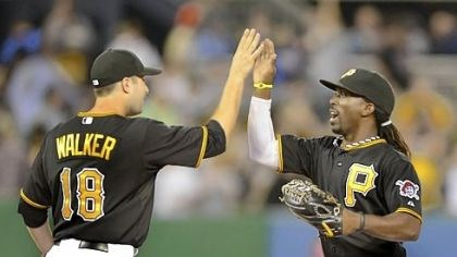 walker Pirates second baseman Neil Walker celebrates with center fielder Andrew McCutchen after beating the Marlins.