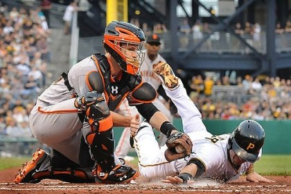 walker out at home Neil Walker is tagged out at home by Giants catcher Buster Posey.