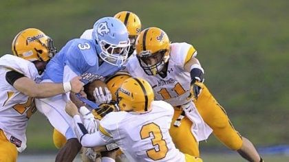 Warriors Central Valley's Jordan Whitehead, being gang-tackled by Montour defenders, leads the Warriors rushing attack.