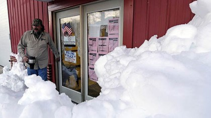 West Virginia snow voting Not that far from Pittsburgh: Snow surrounds the polling precinct in Terra Alta, W.Va., as Peter Hough heads to work after casting his ballot.