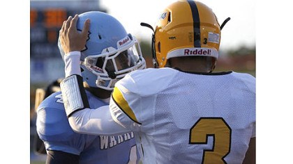 wilson Montour receiver Devin Wilson, right, greets Central Valley receiver Robert Foster before the start of their game Thursday at Central Valley.