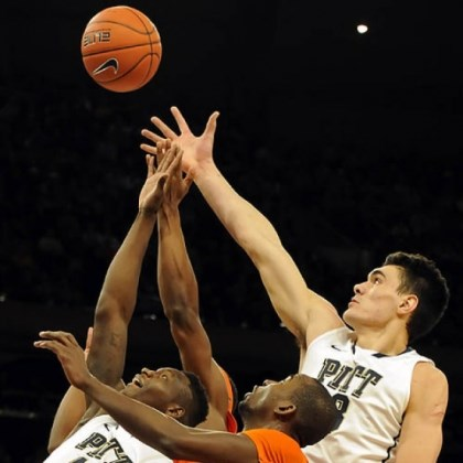 zanna Pitt's Talib Zanna and Steven Adams reach for a rebound against Syracuse's Baye Moussa Keita in the first half of the Big East Championship quarterfinals at Madison Square Garden Thursday afternoon.