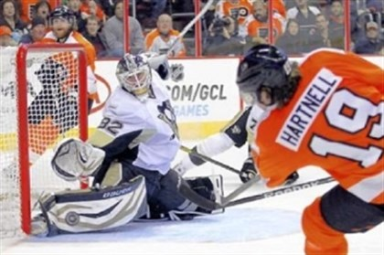 Vokoun Penguins goaltender Tomas Vokoun, left, makes a save on a shot by the Flyers' Scott Hartnell last season in Philadelphia.