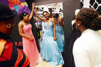 Project Prom 2013 Trying on prom gowns at last year's Project Prom shop at Century III Mall in West Mifflin were Seausa Williams, left, and Yawande Bynum, both of McKeesport. The pop-up shop returns this week to the mall for a limited time.