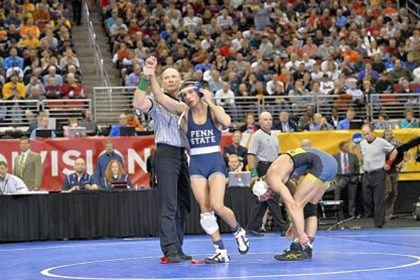 megaludis1 Penn State standout wrestler Nico Megaludis raises his hand in victory.