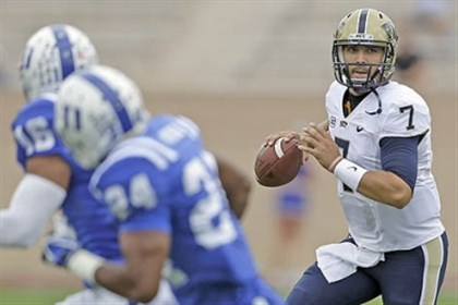 Pit QB Tom Savage in action against Duke Pitt quarterback Tom Savage, shown here looking to pass against Duke during a game last season in Durham, N.C., was among Pitt players showing their skills to NFL scouts yesterday on the South Side.