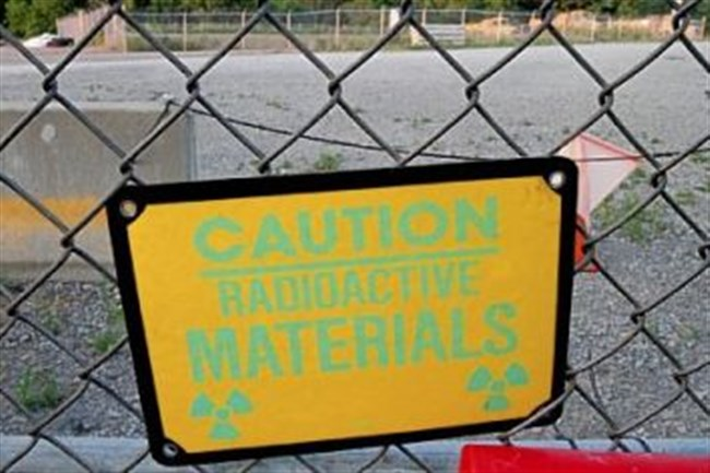 A sign warns of radioactive material at the Parks Township Shallow Land Disposal Area where excavation of nuclear waste was halted by the Corps of Engineers.