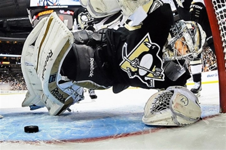 015.jpg Penguins goalie Marc-Andre Fleury makes a big save against the Rangers.
